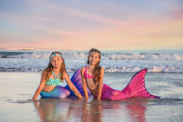 Two mermaids on the beach in San Diego