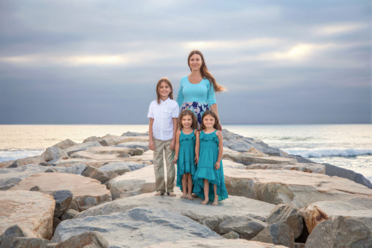 Family on South Ponto Beach Jetty in Carlsbad