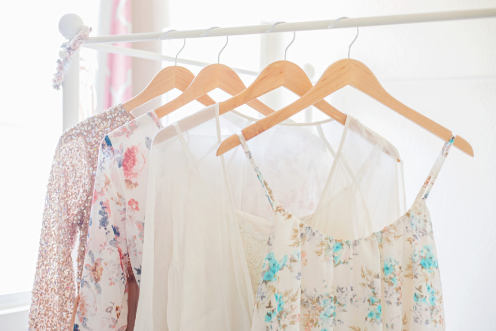 Selection of beautiful floral dresses hanging up