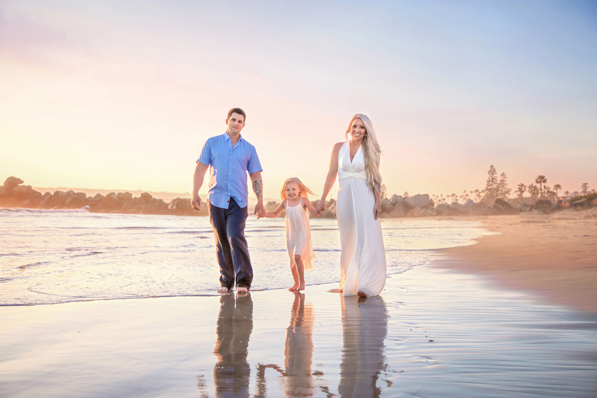 Family walking along the beach for San Diego Family Photographer Baobab Photography
