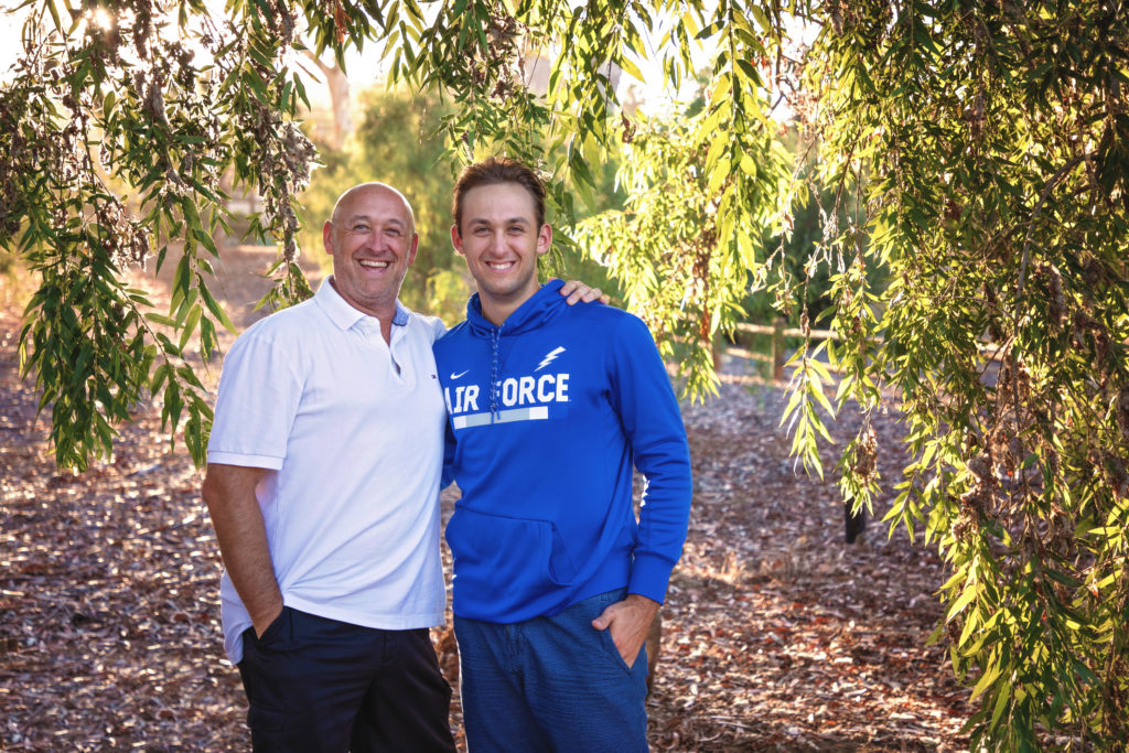 Father and son standing under a tree at Olivenhain Town Hall in Encinitas.
