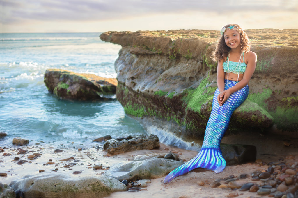 San Diego Mermaid sitting on a rock