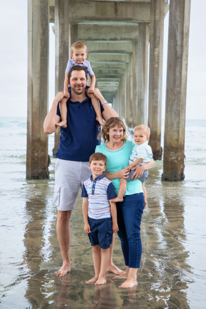 Family standing underneath Scripps Pier in La Jolla