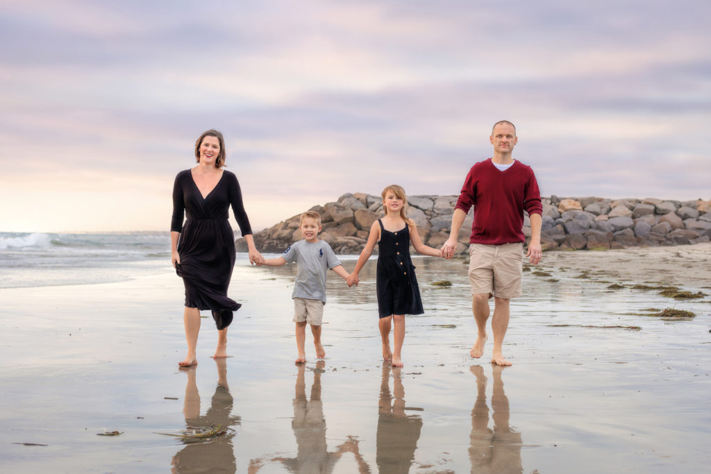 Family walking along South Ponto Beach in Carlsbad