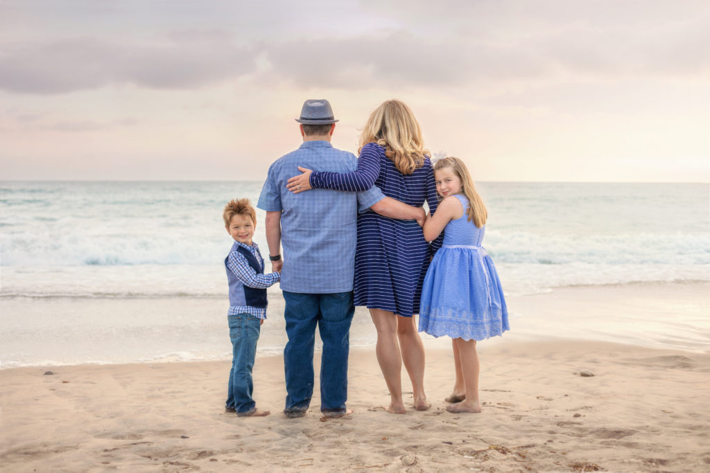 Family standing together at South Ponto Beach