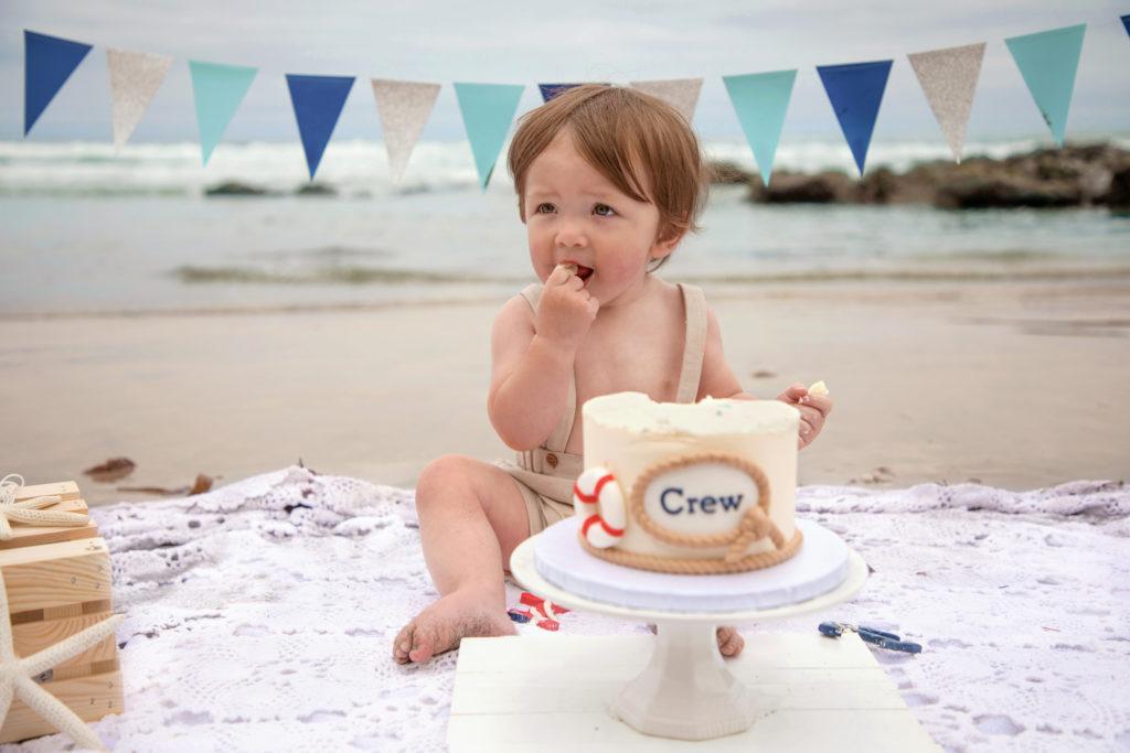 Baby boy nautical cake smash on the beach at Scripps Pier in La Jolla