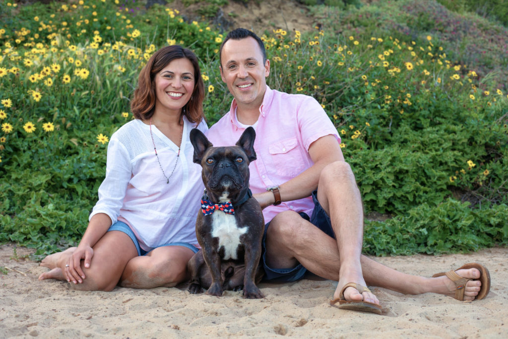 Beach family photo shoot with dog wearing a bowtie.