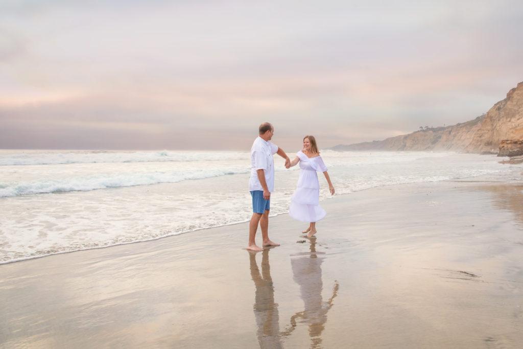 Couple dancing on the beach in La Jolla.